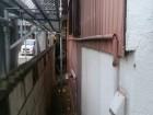 外壁の重ね張り工事の現地調査の様子