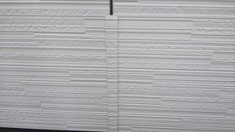外壁カバーサイディング工事施工中の様子