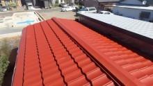トタン屋根錆止め施工中の写真